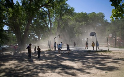 Lakota youth play basketball during the Oglala Lakota Nation Pow Wow.  Lakotas celebrate throughout late summer with Sun Dances and Pow Wows across the reservation.