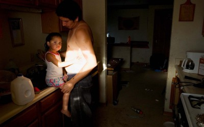 Father and daughter, Allen, Pine Ridge Reservation.  Allen has been called the poorest town in America.  Over 90 percent of Pine Ridge residents live below the federal poverty line, and the unemployment rate hovers between 85 and 90 percent.