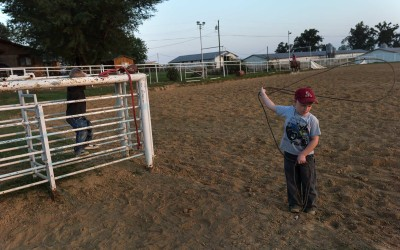 Springdale, Arkansas: Marlene and Virgil Moore keep a roping arena at their Springdale home. A child practices his cowboying skills.