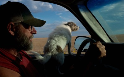 Hay Springs, Nebraska.August 29, 2012..Jim Mracek and his dog drive through Sheridan County in search of the priarie fires that have started from lighting because of the extremely dry condition of the land during the drought. Often, due to the remote location and limited firefighting resources, ranchers and their neighbors have to try and put the fires out themselves.