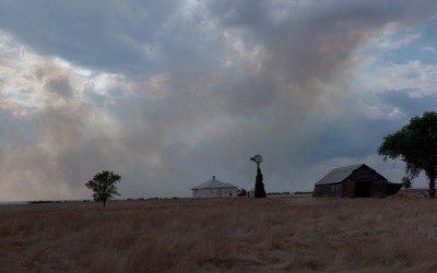 Hay Springs, Nebraska August 28, 2012  Smoke from prairie fires drifts past an abandoned farm house. The dry conditions brought on by the drought have threatened many farms with wildfires started by lighting.