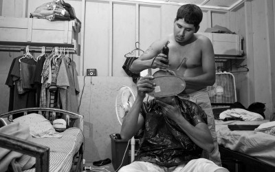 Clinton, North Carolina September 2011  Rodrigo Martinez gives his roommate Jesus Garcia a haircut.