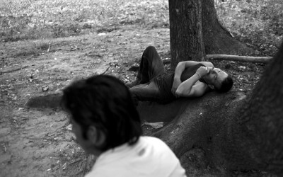 Clinton, North Carolina. September 2011  Migrant workers relax after working a 12 hour work day. On average they workers make about $65 a day from picking tobacco or other crops.