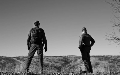 Nogales, Arizona.  USA 2013 - US border patrol agents looks for tracks left behind by migrants who cross into the United States from  Nogales, Sonora, Mexico, into Nogales Arizona.