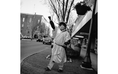 A man dressed as the Statue of Liberty hands out leaflets for an income tax preparation service, Tiffin, Ohio.