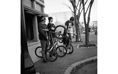 Teenagers with bicycles.