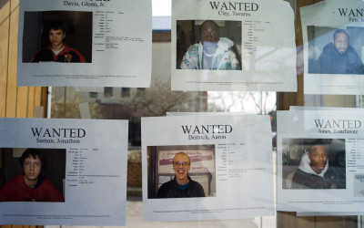 Wanted posters taped on the window of the Allen County Sheriff's Office, a storefront in downtown Lima. It is not stated on each notice what each person is wanted for, but requests that the Allen County Probation Department be notified.
