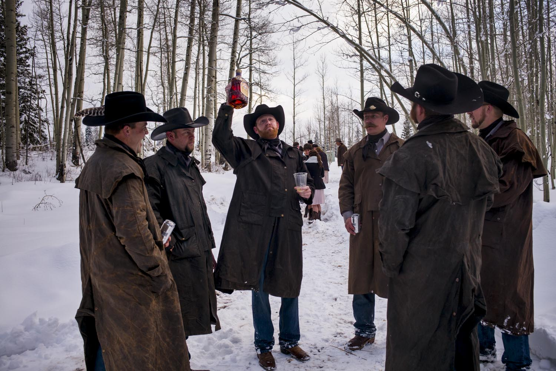 Matt raises a bottle of whiskey in toast to Josh and Kelsea