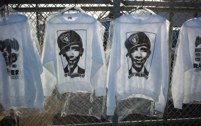 T-shirts for sale on International Avenue, with Oakland Raiders and Obama theme.