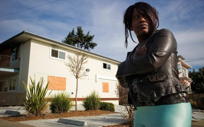 """""""Rolling twenties"""" A young junkie prostitute standing on the corner of an abandoned housing complex. Most of these homes have been foreclosed by the banks."""