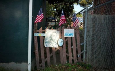God bless Jesus, American flags. East Oakland.