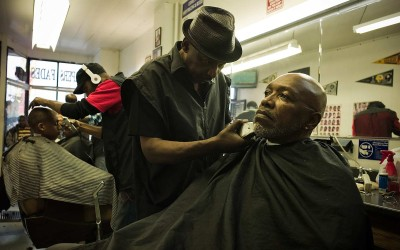The Deacon, 59, and TCinque Sampson, 57, former street enforcers for drug dealers in Oakland. The Deacon was never busted and became a barber, as a part-time profession between killings. TCinque Sampson did 22 years in prison and is now a filmmaker. Being an enforcer was a violent occupation, very few survived.