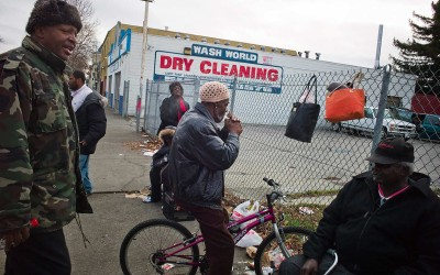 """All in the game, smoking crack: Street dealer selling crack to a user on his bike. """"The mayor is overseeing the selling."""" (The """"mayor"""" is Ronnie, a drug dealer and former nightclub owner.) Many areas of East Oakland have been plagued by high crime, violence and drug activity."""