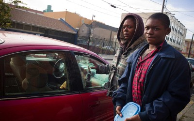Jamal, 13, and his mother Tricia are homeless and living in their car with their dog. They get meals from the Society of Saint Vincent de Paul's food program.
