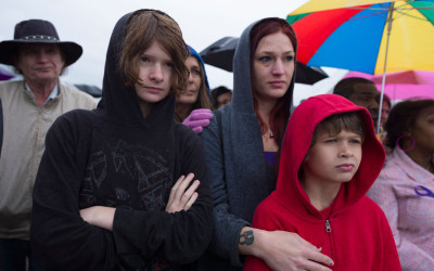 """For the first time, Sarah, her sons and her parents stood publicly with other victims of domestic violence at """"Meet Us at the Bridge,"""" an annual event sponsored by the Nashville Coalition Against Domestic Violence."""