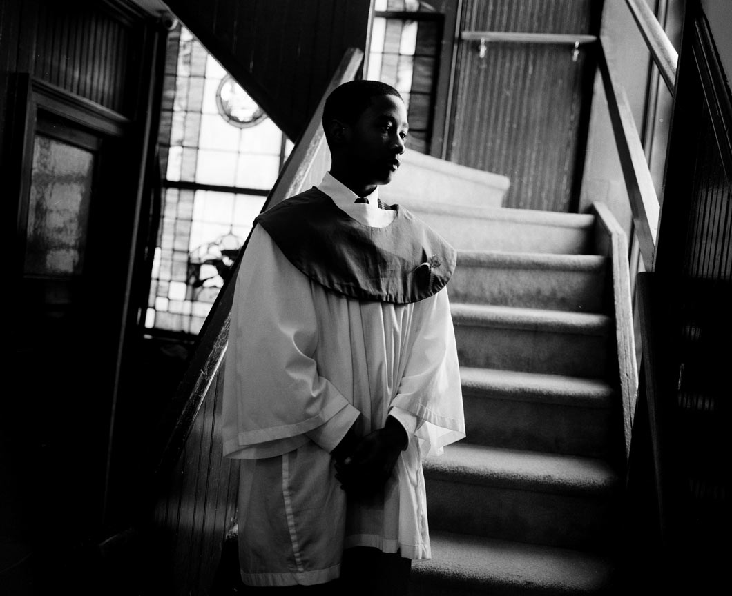 A choir boy stands in Emanuel AME's entranceway in 2012.